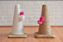 DIY Cat Products / In need of a scratching post? Cat toy? Litter box? Instead of running to the nearest pet store, try making one of these cat DIYs!