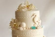 Beach Themed Cakes / These cakes deserve your consideration for your St. Thomas wedding. In my opinion, beach themed cakes for a destination wedding are hard to find, but these cakes are both elegant and beachy.  Usually they incorporate chocolate shells and other decor, but not always. Regardless, any of these cakes would be the perfect compliment your your beach wedding package in St. Thomas or a beach themed wedding anywhere.