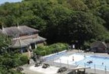 Osmington Holiday Park / Lodge Holidays and ownership in Weymouth, Dorset. A tranquil haven for you and your family.  Imagine leaving the crowds behind, winding down a country lane, finding yourself in a pretty wooded valley, or landing on a beach which has spectacular sea views - that's Osmington. Top standard holiday lodges, heated outdoor pool and terrace, The Country Club exclusive bar and restaurant - This is 'The Best Of Dorset'.
