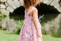 Angelina / Angelina makes the most of the summer; whether picking daisies or eating strawberries, she loves wearing her colourful patterned summer dresses where ever she goes. With the perfect style and a range of patterns and designs, Angelina dresses can be worn to all occasions.