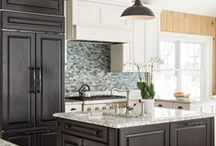 Cape Cod Lake Home / Dark Cherry cabinetry with glazed painted white cabinetry and granite counter tops