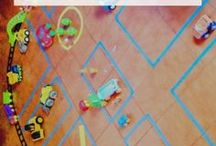 Make These Toys Yourself / Tape on the floor -- who knew a whole city, with rules for parking and driving, was hiding inside that tape! Work together with your child to make the roads, and let them at it -- he or she will be busy for a while!