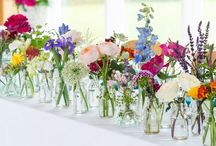 Flowers in glass jars and bottles  / Glass jars, bottles and vases filled with flowers.