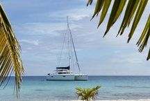 Come Sail Away / With a variety of stunning islands to explore, one of the best ways to experience the diversity of our locations is by sea. Glide blissfully along the remarkable blue waters with views of endless horizons, captivating sunsets, impressive mountain peaks, and lush tropical landscapes.