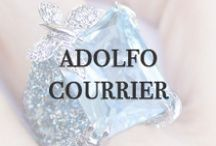 Adolfo Courrier / Adolfo Courrier makes the most of color and texture contrast in his designs. He marries the traditional art of enameling jewelry with modern effects like thematic amours and adorns his pieces with very finely cut colored gemstones that require intricate setting. Adolfo Courrier designer jewelry is available at Oster Jewelers and osterjewelers.com