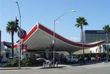 Inspiration | Googie / Googie architecture is a form of modern architecture, a subdivision of futurist architecture influenced by car culture, jets, the Space Age, and the Atomic Age.[1] Originating in Southern California during the late 1940s and continuing approximately into the mid-1960s, Googie-themed architecture was popular among motels, coffee houses and gas stations.