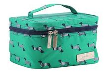 Coney Island: Ju-Ju-Be Coastal / Capture the simple pleasures of strolling New York's most famous boardwalk each time you carry this fun Coastal print! A darling tribute to Coney Island and its famous hotdogs, navy wiener dogs (wearing little striped sweaters!!) prance across a deep green backdrop. True to Coastal form, our Providence print provides a complementary mix and match interior with silver hardware as the flawless finishing touch. Now Available!