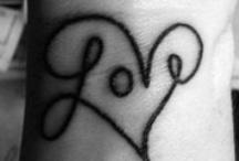 tattoos <3 / by Terri Laidlaw