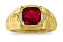 Mens Ruby Rings / Men's Ruby Rings From Gemologica.com. Let us help you find the perfect men's ruby ring! Our ruby rings for men are crafted of .925 sterling silver, 10K and 14K yellow gold and white gold, and are tastefully accented with diamonds.