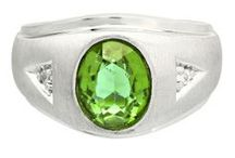 Mens Peridot Rings / Men's Peridot Rings From Gemologica.com. Let us help you find the perfect men's peridot ring! Our peridot rings for men are crafted of .925 sterling silver, 10K and 14K yellow gold and white gold, and are tastefully accented with diamonds.