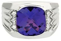 Mens Tanzanite Rings / Men's Tanzanite Rings From Gemologica.com. Let us help you find the perfect men's tanzanite ring! Our tanzanite rings for men are crafted of .925 sterling silver, 10K and 14K yellow gold and white gold, and are tastefully accented with diamonds.