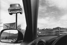 Lee Friedlander - America by Car / · 2013 · Foam proudly presented a solo exhibition by the American photographer Lee Friedlander (1934, US). This exhibition features the series America by Car and The New Cars 1964. The automobile has come to symbolize the American dream and the associated urge for freedom. It is therefore no surprise that cars play a central role in both series, now receiving their first showing in the Netherlands.
