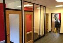 """Partitioning / We provide glass partition and solid partition systems that will meet the needs of today's modern working environments. Partition systems offer an ideal solution for creating offices, meeting rooms, staff dining, toilets or quiet areas, allowing effective use of the space that you have available. Frameless glass partitions can be used to give that feeling of """"open plan"""" with added privacy. www.hantscr-ltd.co.uk"""