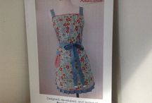 Aprons by Shari / These lovely aprons were made in our shop out of our Favorite Moda fabrics
