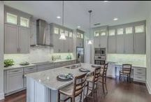 "Kitchen Design / At Tidewater Homes, we pride ourselves in designing usable, family friendly kitchens.  All of our kitchens come with granite countertops with undermount sinks, Bosch stainless steel appliances and 42"" cabinets with full overlay doors."