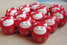 Lucky Cat / The Maneki-Neko is a common Japanese lucky charm. Possessing a lucky cat is believed to bring good luck and fortune to the owner. Japanese Cats are also known as money cats, happy cats, beckoning cats, welcoming cats and fortune cats - what could be better than that?!