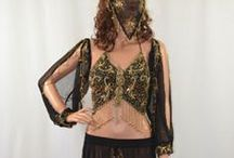 Belly Dancing Clothes and Jewelry / Belly Dancing Clothes and Jewelry.   Belly Dance We have a very large selection of belly dancing items: Costumes, Tribal & Gypsy, Hip Scarves, Bras & Tops, Jewelry, Belts, Skirts, Pants, Veils & Wings, Goddess Size Costumes, Finger Cymbals, & Kids Costumes  http://www.zarinas.com/bellydancing.shtml