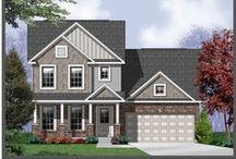 The Kennesaw / The Kennesaw is a unique 1 1/2 story home offered in our Hometown Collection. It features 3 bedrooms, 2 1/2 bathrooms, and 2,353 square feet of living space.
