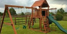 Cowtown Series Backyard Playsets / The Cowtown playset series are budget friendly redwood playsets designed for younger children. The Wrangler and Rustler offers several play options and upgrades to keep your school age children active in your backyard.