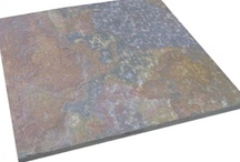 Rajah Slate - Bellstone / Rajah has a variety of colours - orange, ochre, pink, purple, green & grey. It is a softer, more porous slate than our other slates so it is best suited to internal areas.Rajah slate splits naturally along planes revealing pallets of vivid pink and purple colour not seen in stone with processed surfaces. The topography of the surface is intricate and has character, depth and grain.