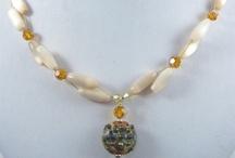 Noell Desiree / Swarovski crystals, sterling silver findings, pendants, gemstones, and more!