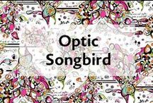 """Optic Songbird / Songbird has a whimsical, musical theme with lines of abstract sheet music and features a peacock symbolizing beauty and integrity. The print symbolizes that """"the music and rhythm give us infinite love"""" http://sakroots.com/artist-circle-josana-blue"""