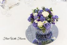 blue wedding flowers blue bridal flowers shower bouquet, table centre candelabras, martini vases, goldfish bowl, top table civil arrangement venue dressing flowers. / blue flowers for wedding bouquets and venues Gerbera  wedding flowers bridal flowers shower bouquet table centre candelabras martini vases small glass vases glass cubes goldfish bowl top table civil arrangement venue flowers abbey hotel redditch