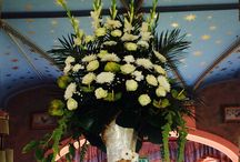Disney theme wedding flowers table centres and venue flowers / Wedding flowers at an old English castle with a fairy tail theme  Walt Disney table centres top table tangled individual table centres beauty and the beast, lion king, Cinderella, Aladdin and pirates of the Caribbean at studley castle