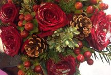 Christmas wedding flowers / Christmas themes weddings in reds and Ivory flowers with silver and berries cones and foliage season Christmas bridal flowers church venues and receptions