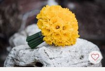 Yellow wedding flowers / Brides and bridesmaids bouquets in bright yellow with centre pieces and church flowers
