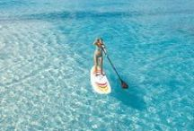 Stand Up Paddle Boarding / Everyone HAS to try stand up paddle boarding!!!  So much fun and what better way to try it than on  clear aqua water, palm lined beaches and beautiful lagoons like at Macaronis Resort!