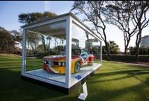 """""""The Jewel Box"""" **Feature Project** / The Exhibit Company, Inc. was given the challenge of creating a weather-proof, climate-controlled glass enclosure for BMW's priceless vehicles, also known as """"Art Cars"""". The weather-resistant enclosure comfortably secures one (1) BMW Art Car in any outdoor venue or setting."""