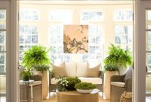 Sun Room / Interior design and decor inspiration for a light-filled room with three walls of windows. A place perfect for enjoying horticulture, reading, relaxing and conversation