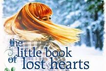 The Little Book of Lost Hearts / When a stranger called Rufus moves into the grim, grey house opposite Antoinette Ellis's cottage, odd things start to happen in Fools Castle. He admits he's not the person he appears to be, but he won't reveal who he really is. And what secrets lie within that little old book of his, which no one is allowed to look inside?