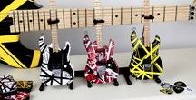 EVH Miniature Guitars / After years of careful planning, intensive prototyping and meticulous product development, we are proud to offer these hand made Official miniature EVH replica guitars!  Official EVH approved mini guitar collection that has the endorsement of Eddie himself!