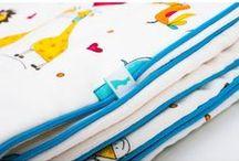 Lapinoo Kocyk Bambusowy Safari - biały-turkus / Lapinoo to francuska marka oferująca wysokiej jakości tekstylia dla dzieci. Marka powstała, opierając swe produkty na unikalnym designie, naturalnych tkaninach i szczególnej dbałości o produkt, jaki trafia w Twoje ręce.