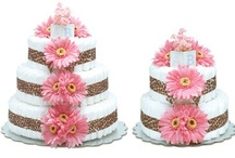 """Diaper Cakes / Whimsical yet practical, Bloomers Baby Diaper Cakes are the perfect gift for new or expectant parents! These beautiful and stylish couture baby diaper """"cakes"""" are actually created with layers of disposable diapers and adorned with cascading silk flowers. Bloomers Baby Diaper Cakes offer fresh and modern baby diaper cake designs in a variety of styles, colors and sizes."""