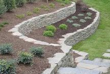 Retaining Wall Ideas / Retaining walls are great for keeping a sloping yard in place, or to ease transitions in your landscaping. Need fill dirt delivered? Need dirt hauled away? We've got you covered. http://www.earthhaulers.com/portfolio/soil-dirt/