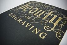 Engraving / Engraving  |  en·grav·ing  |  /enˈgrāviNG/  |  Noun  |  A print made from an engraved plate, block, or other surface.The engraving process imposes ink onto paper under intense pressure creating raised images. Type and graphics are etched into metal plates, the recessed images are filled with ink and applied under two tons of pressure per square inch…resulting in a raised image with startling clarity, color purity, and depth. You can visit our website to learn more about the process.