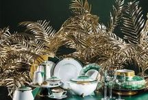 Emerald | Vista Alegre / In the golden era of the Art Deco movement, metals and precious stones were elements usually associated with the geometrization of the patterns, reflecting opulence inherent in artistic creation. The pieces in the Emerald dinner set, richly decorated with matte gold and dark greens, replace excess with elegance, recreating with modernity - using original pieces of the brand from the 30s - the typical exuberance of the period.