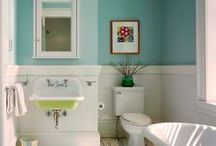 "north: guest bath / aiming for a coastal, bungalow, vintage vibe (inexpensively). main elements: tub+shower combo (probably drop-in tub with facing); 24-30"" vanity; wainscoting (probably wood) possibly topped with accent band+rail; mosaic floor. colors: white, blues. no goddamn shiplap."