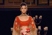 Manish Malhotra's Portraits collection / Manish Malhotra's uses mirror work in this line for the new age bride and groom. Note his idea of using zari embroidery on a 'turtle' neck of a blouse; and the attention to detail on the work on the back of the costumes.