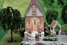 """Quarter Scale Dollhouse Miniature - Willow Cottage / Willow Cottage is a quarter scale, fully furnished, with Shabby Chic Decor. It measures 3.25""""W x 7""""H x 5.5""""D.  The base it sits on measures 13.25""""L x 11.25""""W."""