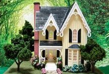 """1:48 Scale Miniature Quarter Scale Dollhouse / Love Thy Cottage - Handcrafted Miniature in quarter scale at Norman's Country Creek. Dollhouse measures 10.5""""W x 9.5""""H x 7.5""""D. It sits on a board that is 12"""" x 12.5""""."""