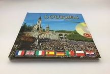 Books, DVDs & other media / Lourdes Books Telling Stories and Facts of the Apparitions. Books of St Bernadette telling her story, information books and DVD all providing information on the special event that took place in 1858. We have booklets and postcards with picture of the impressive and magnificent torchlight processions that take place in the Sanctuary of Lourdes.