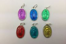 Pendants & Medals (Enameled) / Medals of the Virgin Mary containing Lourdes Water, Medals of the Apparition Containing Lourdes Water, Miraculous Medals, Virgin Mary Medals and Pins are all Enameled. Lourdes water medals contain actual water drawn from the miraculous spring at the grotto.
