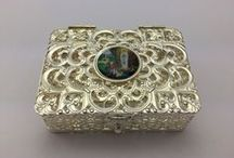 Rosary Boxes / Rosary Boxes in Silver, Pearl and Plastic all depicting the Apparitions in different Shapes and Sizes.