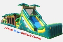 Put Some Bounce In It! / Jump and Slide Entertainment has bounce houses, inflatables, water slides and games for all ages and event themes! Serving Long Island, NY - Call (631) 321-7977