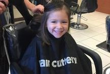 Kids' & Teen Hairstyles / We take the best care of our young guest to give them a look they'll love. Smiles. Guaranteed.