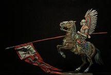 Husaria / Husaria – polska jazda należąca do autoramentu narodowego, znana z wielu zwycięstw formacja kawaleryjska Rzeczypospolitej, obecna na polach bitew od początku XVI wieku do połowy XVIII wieku. Była wykorzystywana do przełamywania sił nieprzyjaciela poprzez zadawanie rozstrzygających uderzeń w postaci szarż, które w najważniejszym okresie jej istnienia kończyły się zazwyczaj zwycięstwami.